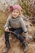 cute child girl on autumn river side