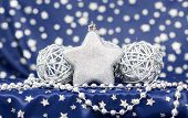 Christmas background with silver Christmas balls and star