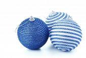 Blue christmas balls on white background