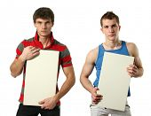 Two young sexy men with copy space blank signs isolated on white