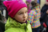 Little girl in a knitted hat and jacket