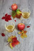 Apple Juice In A Glass, Red Apple And Autumn Leaves