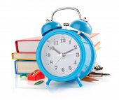 alarm clock and school supplies isolated on white background