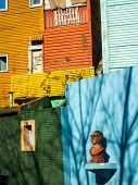 Bust And Colourful Houses In La Boca