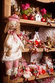 picture of rag-doll  - Wooden shelf in the shop with a set of rag dolls - JPG