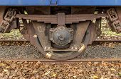 pic of train-wheel  - Detail of a rusty wheel set of a train - JPG