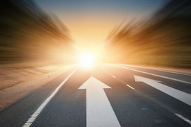 picture of arrow  - Conceptual image of asphalt road and direction arrow - JPG