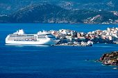 picture of passenger ship  - White passenger ship off the coast of Agios Nikolaos - JPG