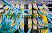 foto of utp  - Optical switch and colorfull FC cables connected equipment in data center - JPG