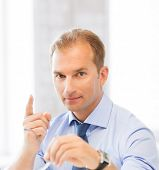 picture of spectacles  - handsome businessman with spectacles showing warning gesture - JPG