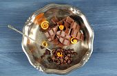 image of orange peel  - Chocolate with orange peels and coffee beans in metal tray on wooden table - JPG