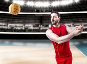 image of volleyball  - Volleyball player on red uniform on volleyball court - JPG