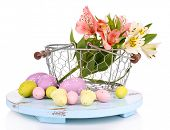 pic of easter basket eggs  - Easter composition with Easter eggs in basket and flowers - JPG