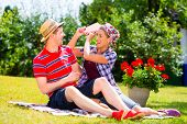 foto of argument  - Couple having argument in garden - JPG