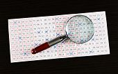 image of lottery winners  - Analyzing lottery ticket with magnifier - JPG