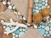 picture of mother-of-pearl  - selection of materials for interior decoration in a nautical theme with a blue ceramic mosaic - JPG