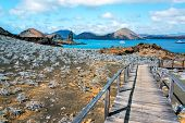 stock photo of rocking  - View of walkway on Bartolome Island with Pinnacle Rock in the background in the Galapagos Islands in Ecuador - JPG