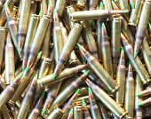 picture of cartridge  - Rifle cartridges loaded with bullets that have a green tip - JPG