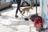 stock photo of begging  - THESSALONIKI GREECE MARCH 28 2015 - JPG