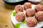 foto of meatball  - Cooking large homemade Italian meatballs for dinner - JPG