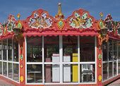 foto of merry-go-round  - Fun fair with merry go round inside a closed booth - JPG