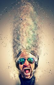 picture of disc jockey  - Crazy screaming disc jockey with headphones and a lot of explosion particles flying get over the air - JPG