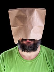 picture of ignore  - Bearded man with paper bag on his head wearing a smile  - JPG