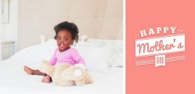 foto of babygro  - mothers day greeting against baby girl in pink babygro sitting on bed - JPG