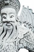 Ancient Lord Stone Statue In Thailand Buddha Temple Isolated