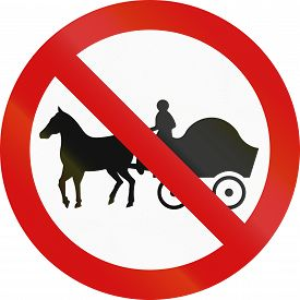 stock photo of carriage horse  - Irish sign prohibiting thoroughfare of horse drawn carriages - JPG