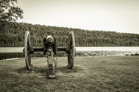 picture of cannon  - Antique cannon on the shore of Lake Fanny Hoe in Fort Wilkins State Historical Park in Copper Harbor - JPG