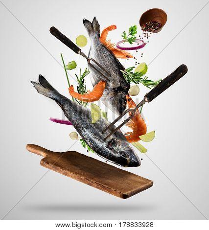 Flying raw whole bream fish