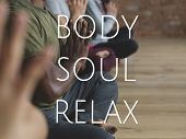 Group of people training in yoga class for body soul and mind relief poster