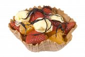 Waffle fruit basket filled with strawberries, satsumas and ice cream drizzled with chocolate sauce