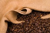 Coffee beans flowing from a sack