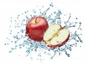 Apple in spray of water. Juicy apple with splash on white background