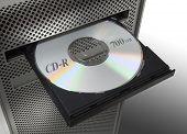Un CD en el lector de CD del ordenador.