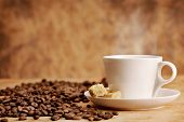 stock photo of cup coffee  - Coffee cup and roasted beans on vintage background - JPG