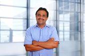 Indian latin businessman blue shirt in modern office background