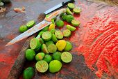 achiote knifes and lemons after preparinng achiote tikinchick Mayan sauce Mexico