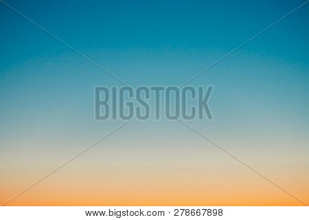 poster of Predawn Clear Sky With Orange Horizon And Blue Atmosphere. Smooth Orange Blue Gradient Of Dawn Sky.