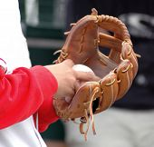 A view into the glove of the pitcher reveals that he is about to throw a wicked splitfinger fast ball.