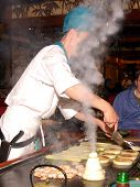 Tap Pan Yaki Chef in action at an upscale Japanese resturaunt .