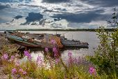The Bank Of The Pur River In The Rays Of The Evening Sun. Old Boats Pulled Ashore. Yamal, Russia. poster