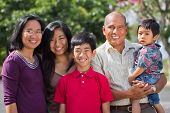 foto of pacific islander ethnicity  - This Filipino family is all smiles posing together in the warm sunshine of the islands - JPG