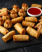 Crispy Chicken Wontons, Vegetable Spring Rolls And Prawn Toasts With Sweet Chilli Sauce. Chinese Sel poster