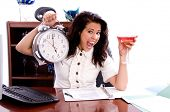 Young professional business woman working in a office holding up a giant clock and a martini at quit