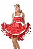 image of nineteen fifties  - pretty blonde pinup model in a red and white polkadot dress - JPG
