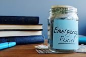Emergency Fund Written On A Jar With Money. poster