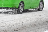 Driving A Car In The Winter  With Snow On The Road. Concept Of Driving In Extreme Weather Conditions poster
